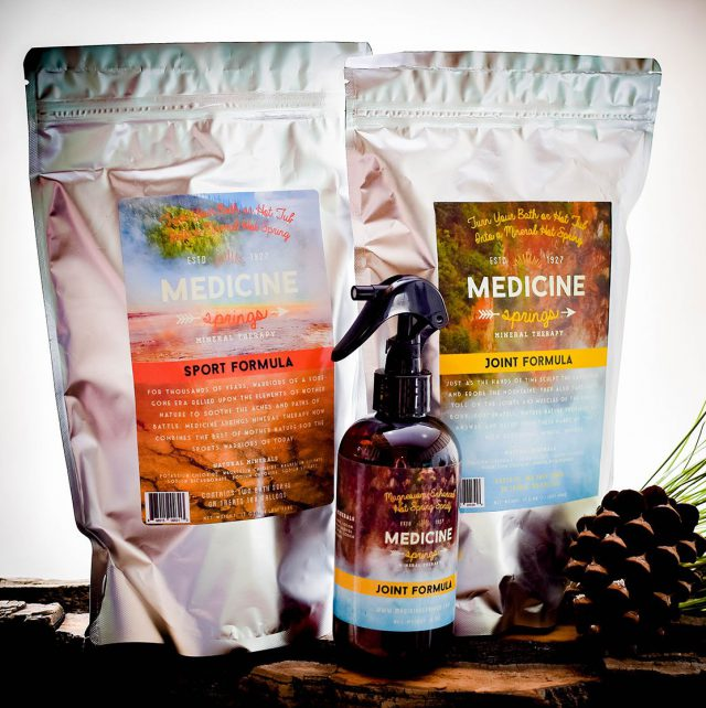 Two pouches of Medicine Springs product. These are the Joint Formula and Sport Formula mineral therapy with a spray bottle of Joint Formula