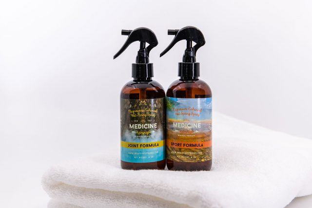Two spray bottles of Medicine Springs product. These are the Joint Formula and Sport Formula mineral therapy.